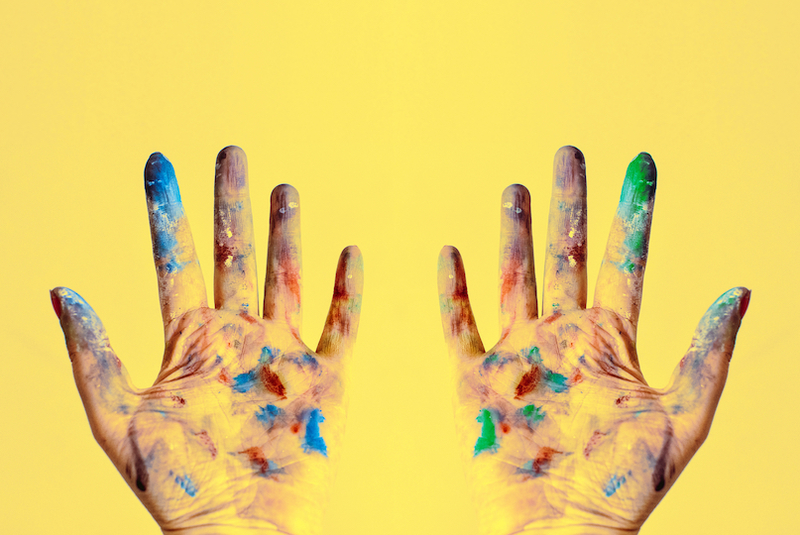 Canva   both hands stained with paints